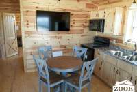 hunting cabin with a kitchen and living area