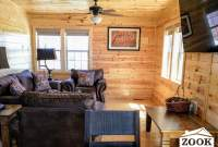 small cabin living area with a television