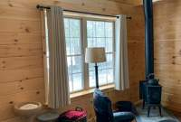 Mountaineer Deluxe log cabin with wood stove