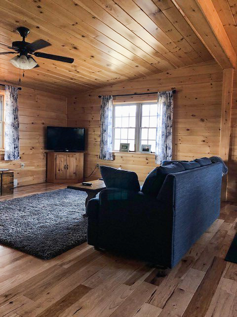 finished living room in kitchen layout in cabin in jerfferson new hamshire