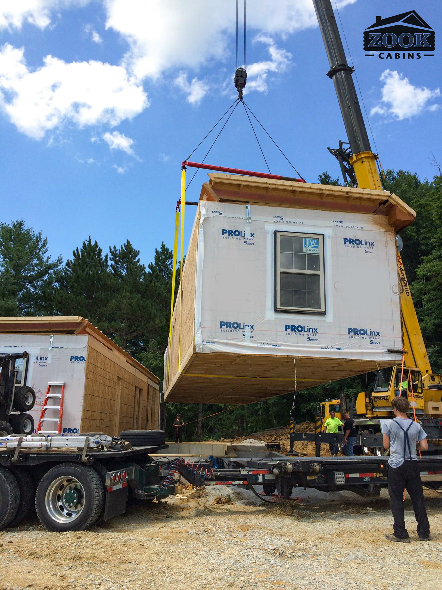 placing modules on cabin in oldenburg indiana