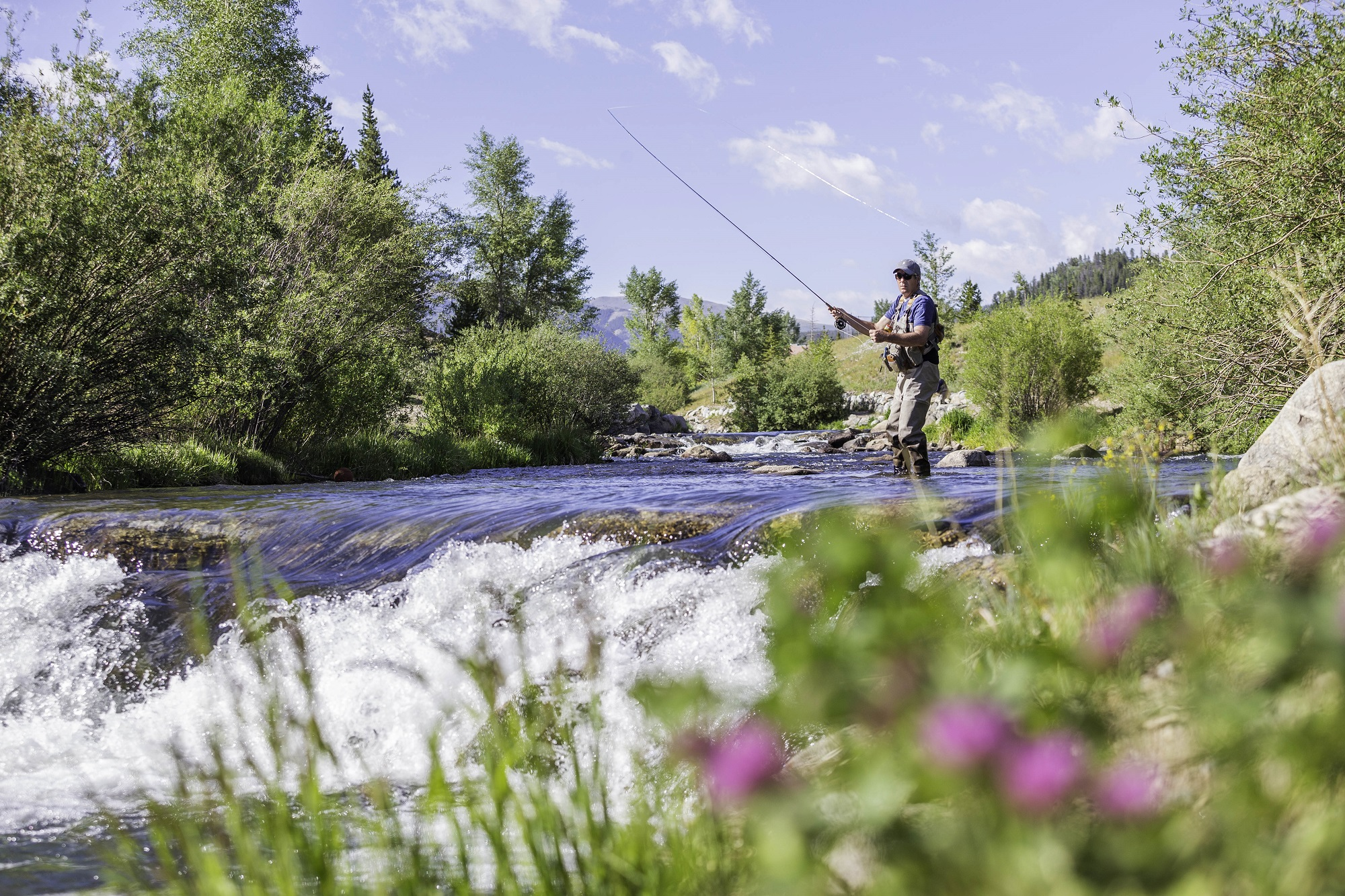 fly fishing by cabin in breckenridge colorado