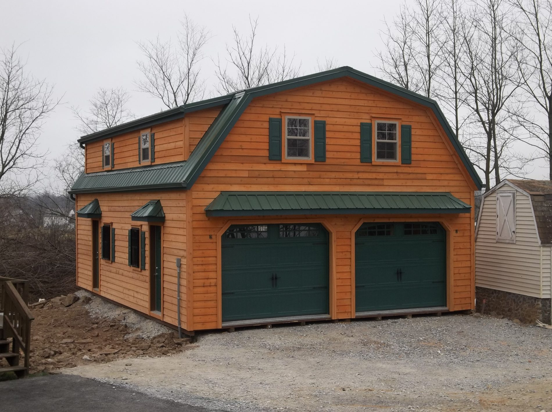 Custom garage builders prefab garages for sale zook cabins for Two story garages for sale