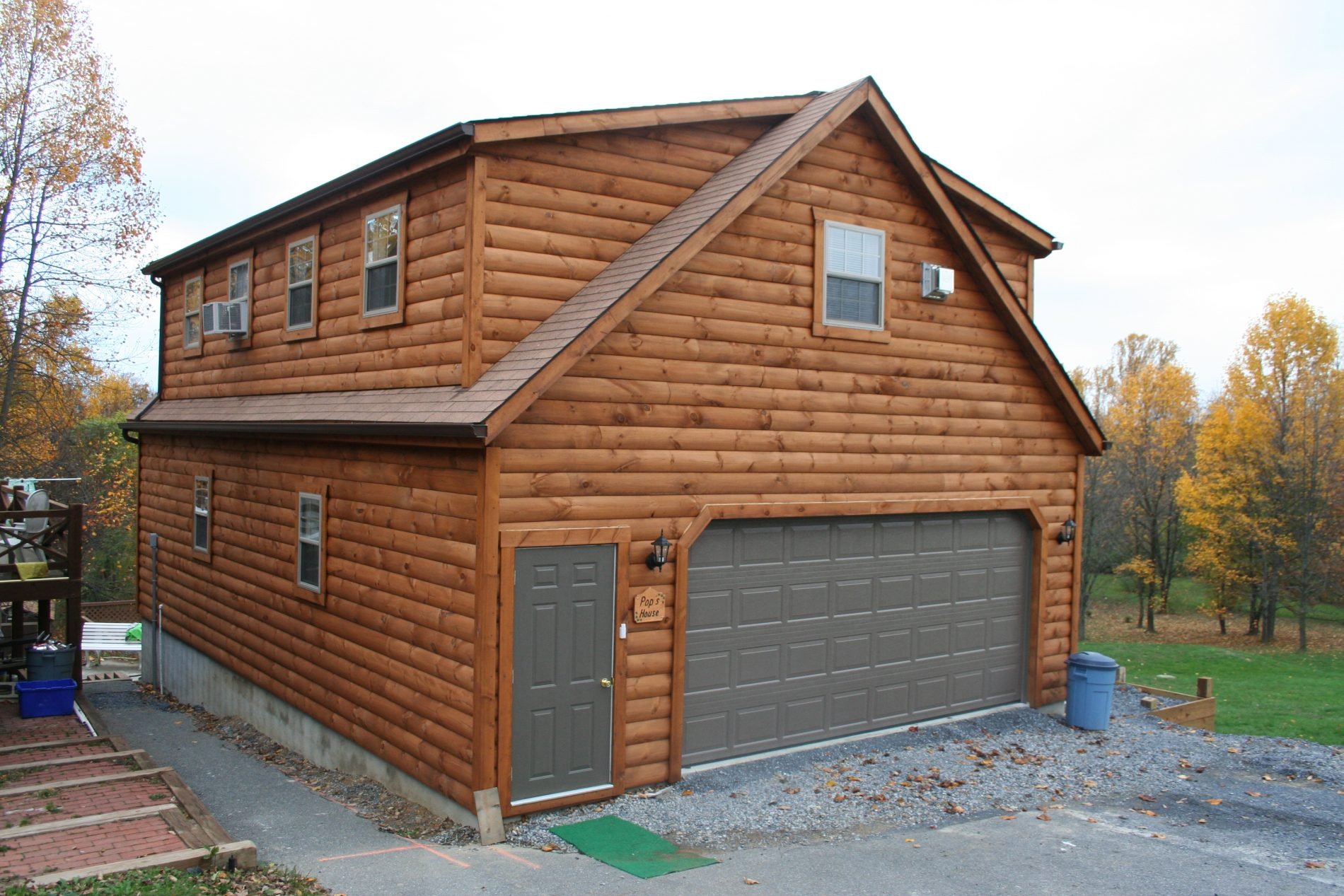 Custom garage builders prefab garages for sale zook cabins for Log cabin house plans with garage