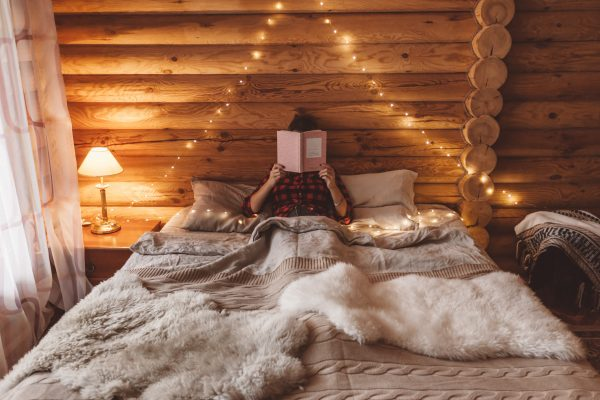 Beautiful bed in a cabin worth living in