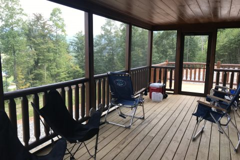 a prefab log cabins screened in deck overlooking the beautiful forest and mountains of parson west virginia