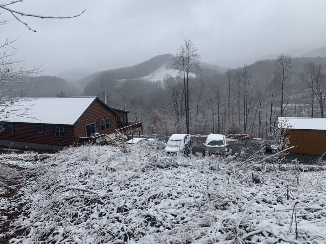 beautiful new prefab log cabin in the snowy moutains of parson west virginia