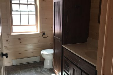beautifully furnished bathroom inside a prefab log cabin in parson west virginia
