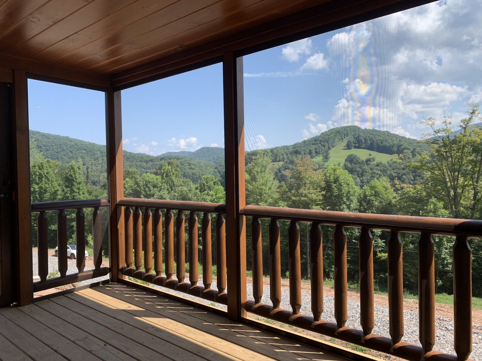 jaw dropping view from the deck of a prefab log cabin overlooking the green moutains of parson west virginia