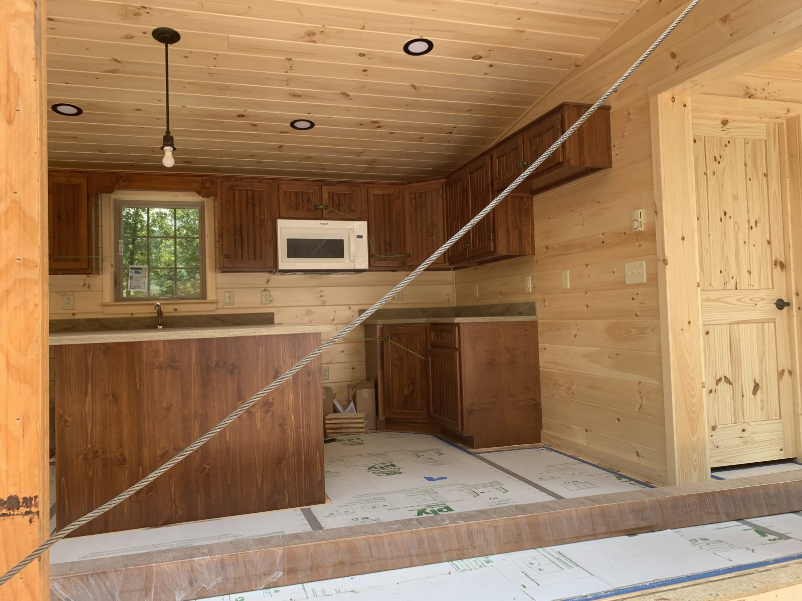 sneak peek at the unassembled pieces of a new prefab log cabin in parson west virginia