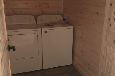 spacious laundry room in a new prefab log cabin