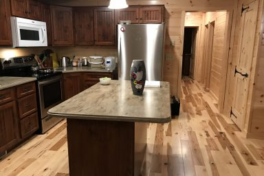 tasteful kitchen with beautiful cabinetry inside a prefab log cabin in parson west virginia