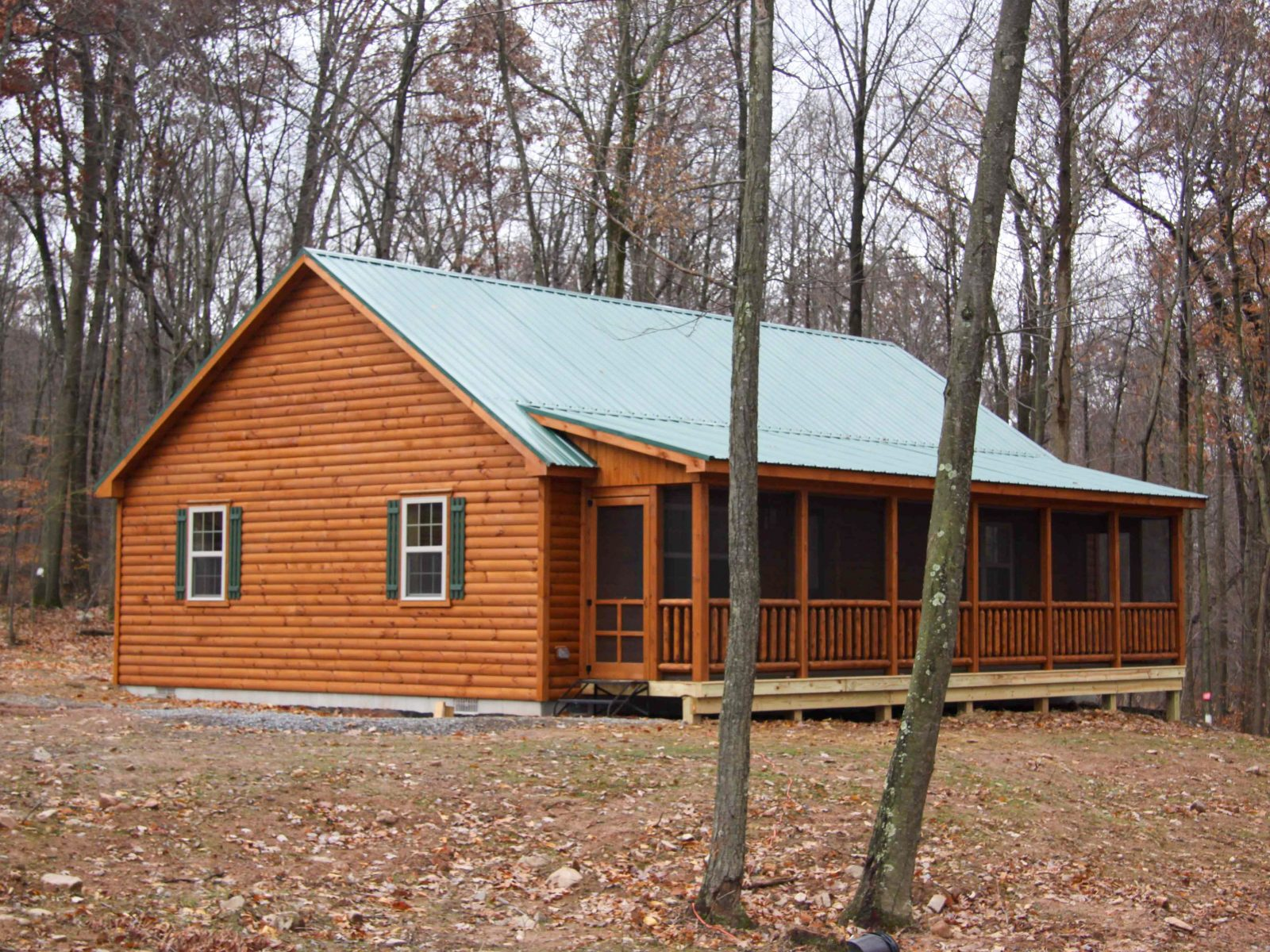 full length side porch on a ranch cabin 1