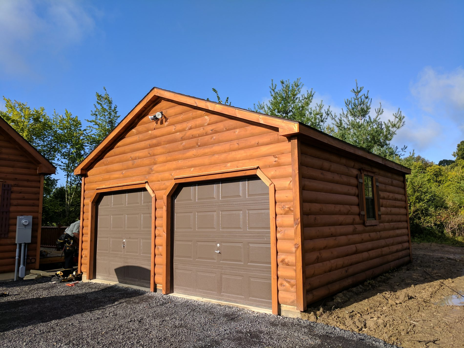 High roof garage prefab garage kits and installation by for Log cabin garage plans
