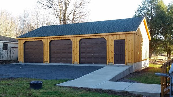 High roof garage prefab garage kits and installation by for Log home garage kits