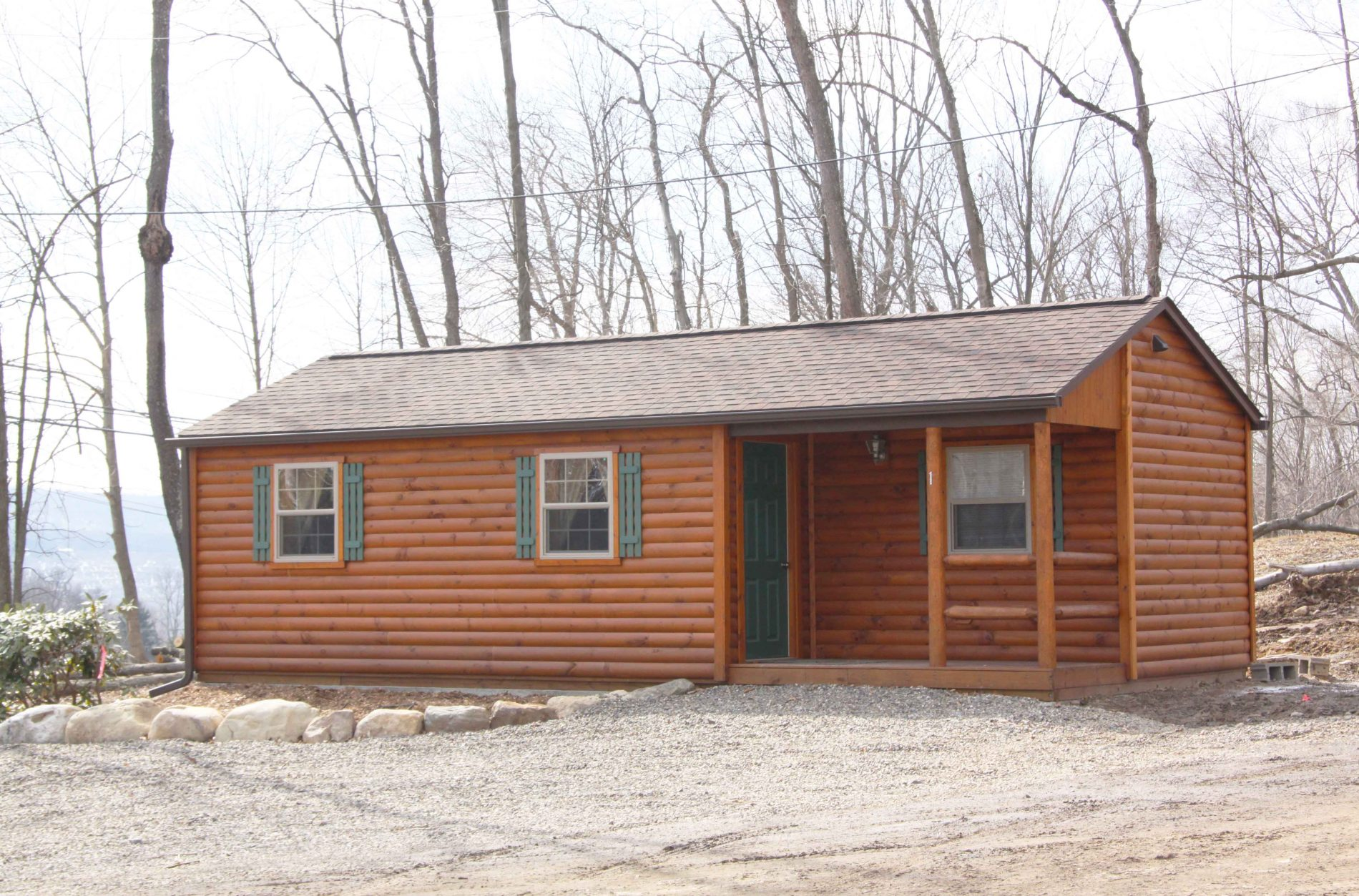 Settler cabin hunting lodge plans small cabin plans for Single wide floor plans with porch